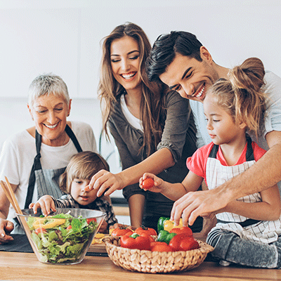 family smiling cooking together