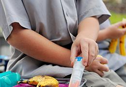 kid pulling EPI Pen out of lunch bag
