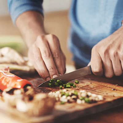chopping vegetables on cutting board